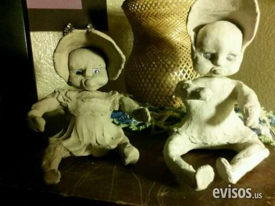 Excellent condition adorable handmade clay babies low price
