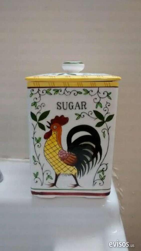 Without any damage vintage sugar canister is by ucagco py .the pattern is rooster roses. sale